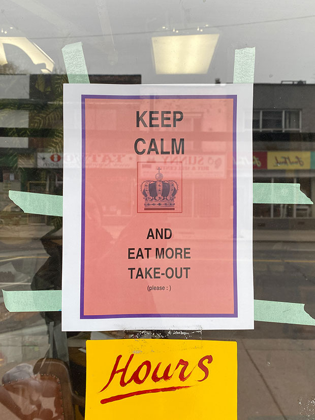 A sign reads 'keep calm and eat more takeout.'