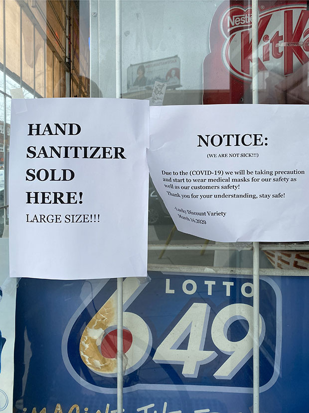 A sign reads 'hand sanitizer sold here! Large size!