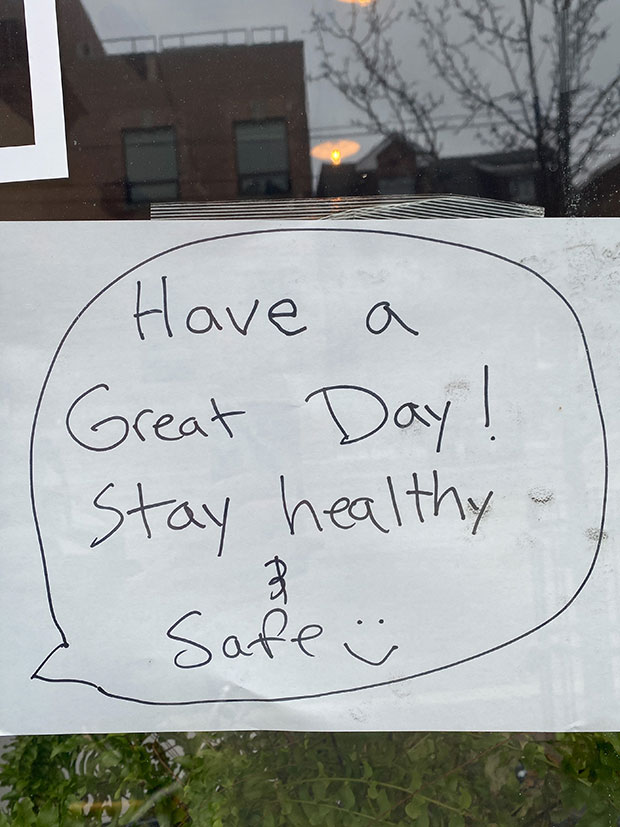 A sign reads 'have a great day! Stay healthy and safe.