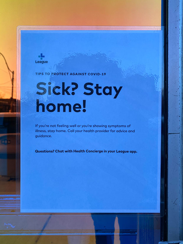 A sign reads 'sick? stay home!