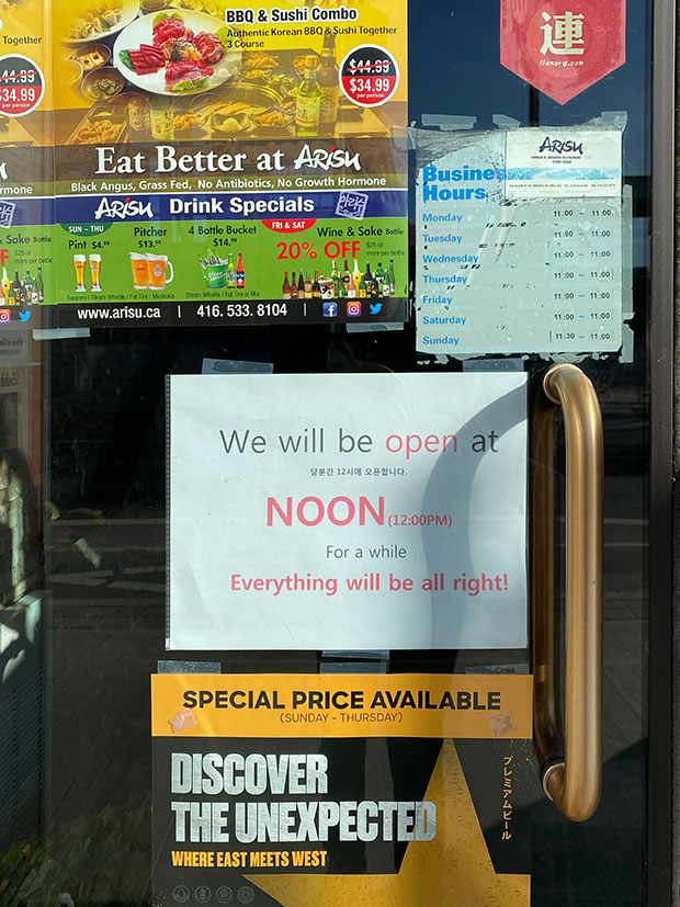 A sign reads 'we will be open at noon. Everything will be all right.