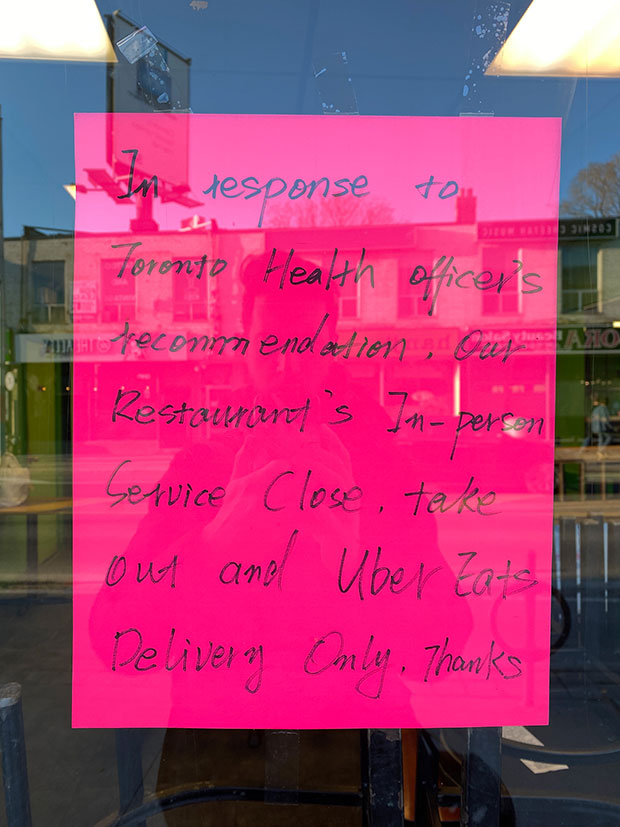A sign reads 'in response to Toronto Health Officer's recommendation, our restaurant's in-person service close.