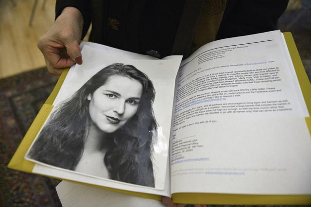 Vicki Schieber holds open a folder containing a photo of her daughter Shannon, who  was raped and murdered in 1998. Ricky Carioti/The Washington Post via Getty Images