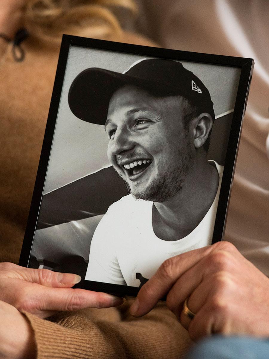 Brad and Debbie Dalke hold a framed photo of their son Brady
