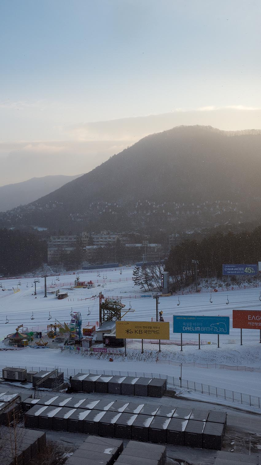 Temporary structures built for the 2018 Olympics are seen at the base of a ski hill at Yongpyong Ski Resort.