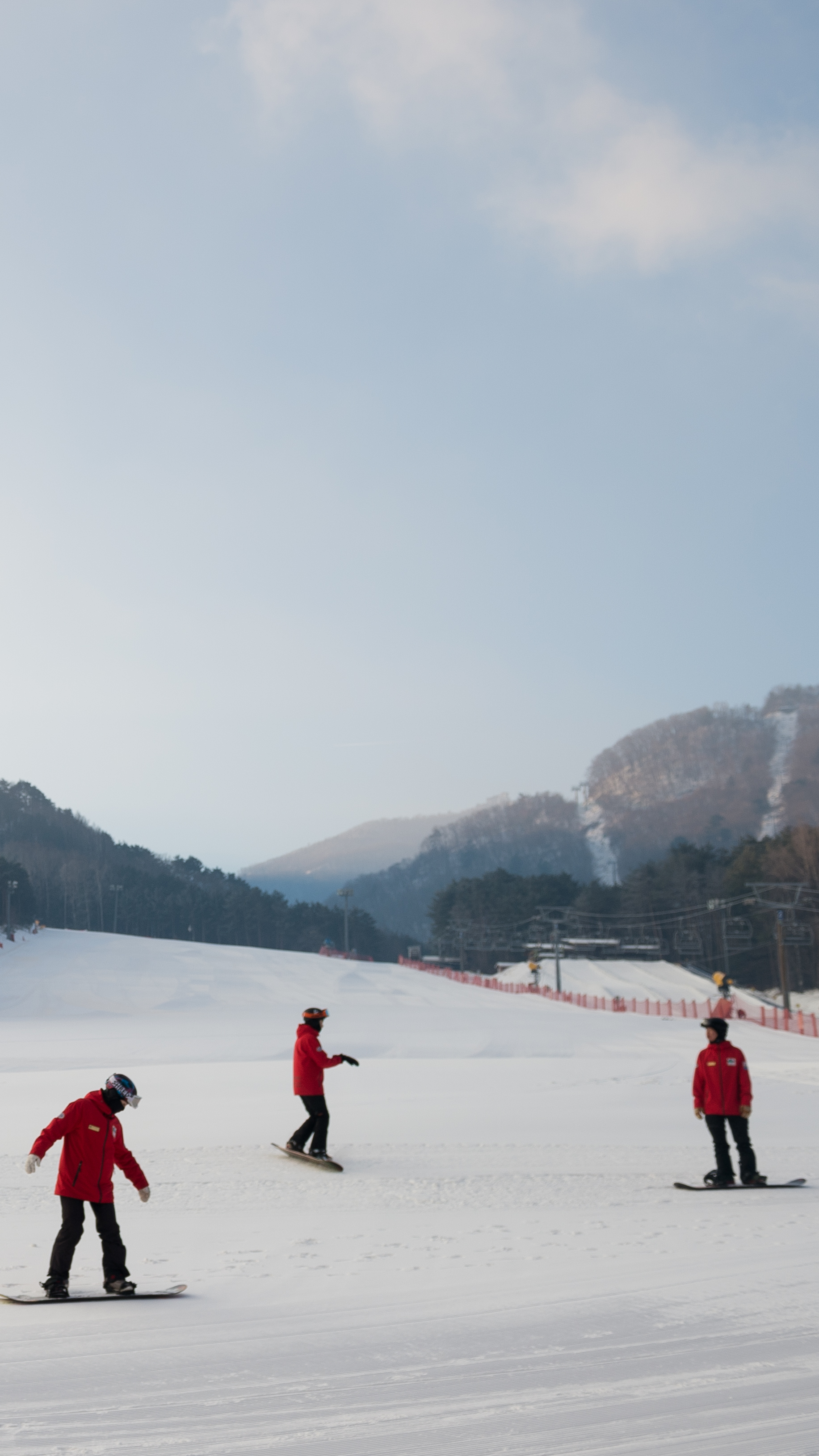Snowboard instructors set out for their shift at Yongpyong Ski Resort.