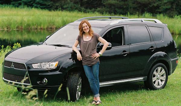 Clara Hughes and her car