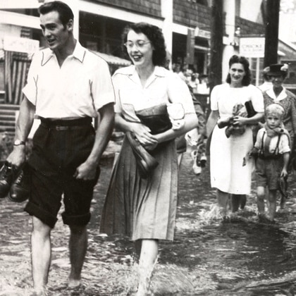 Black and white photo of couple walking together