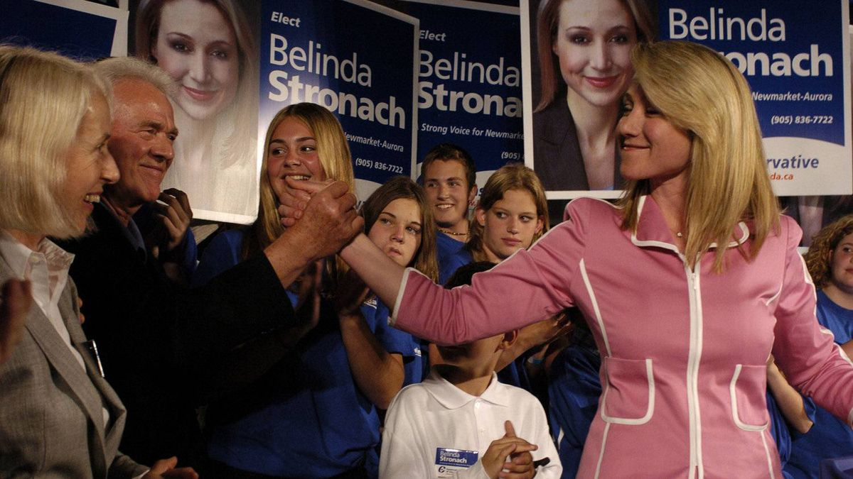 Frank Stronach congratulates his daughter Belinda after she was narrowly elected as the Conservative MP for Newmarket-Aurora by a margin of 689 votes over Liberal Martha Hall Findlay in the 2004 federal election.