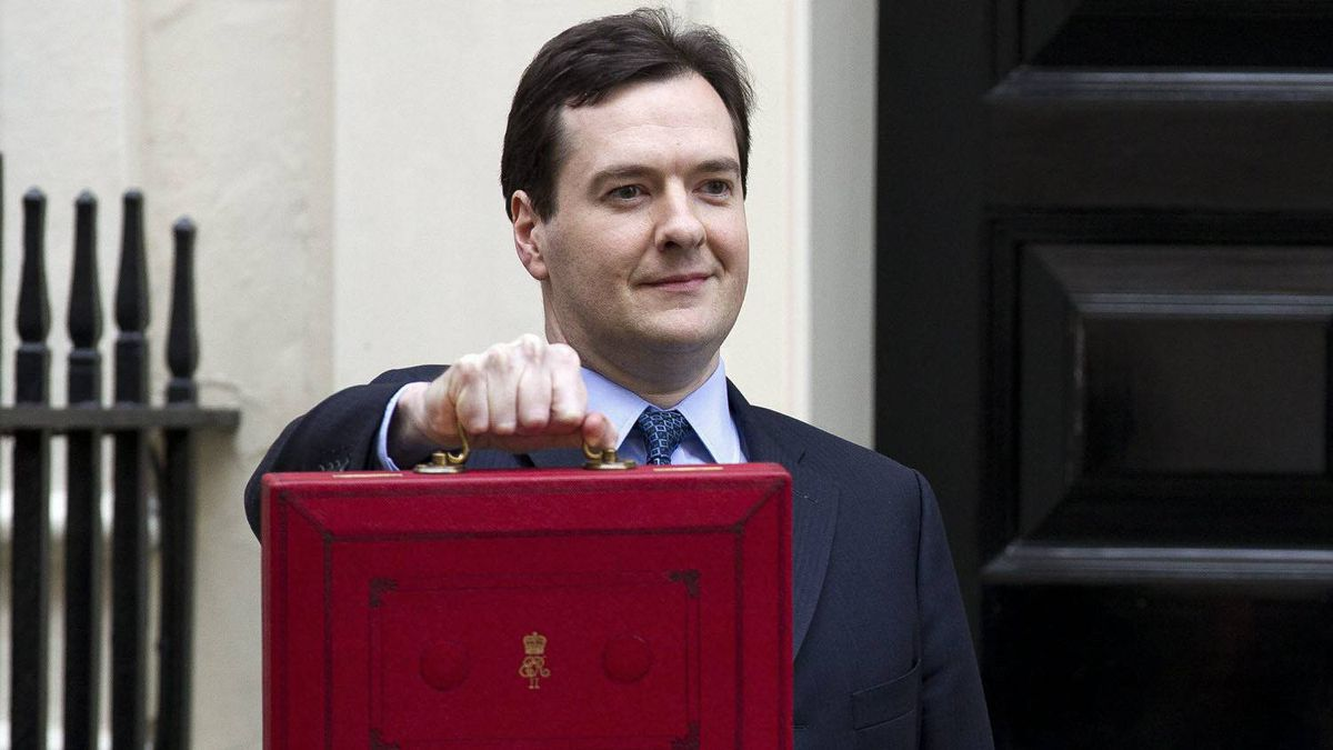 Britain's Chancellor of the Exchequer George Osborne poses for the media with his traditional red dispatch box outside his official residence at No 11 Downing Street in London.