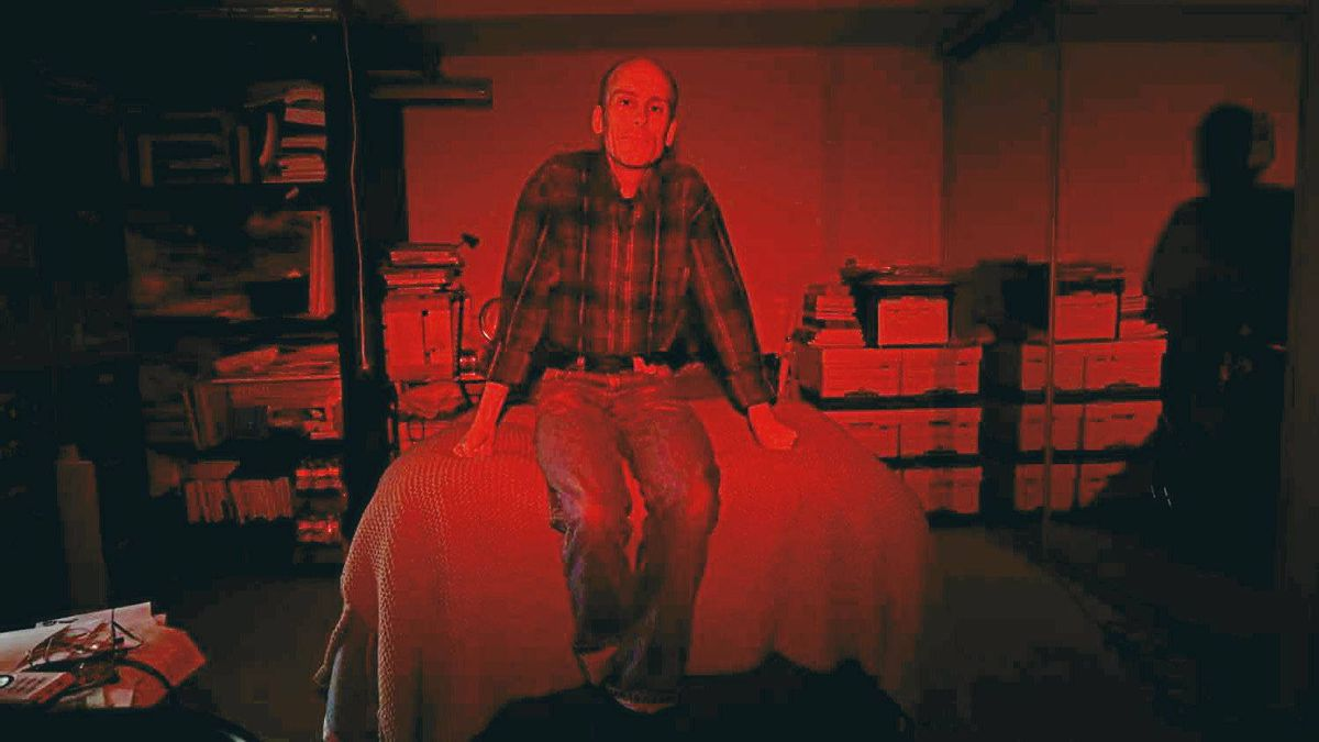 Graphic novelist Chester Brown in his downtown Toronto apartment this month. A red filter was placed over the flash resulting in the overall red cast of the photo.