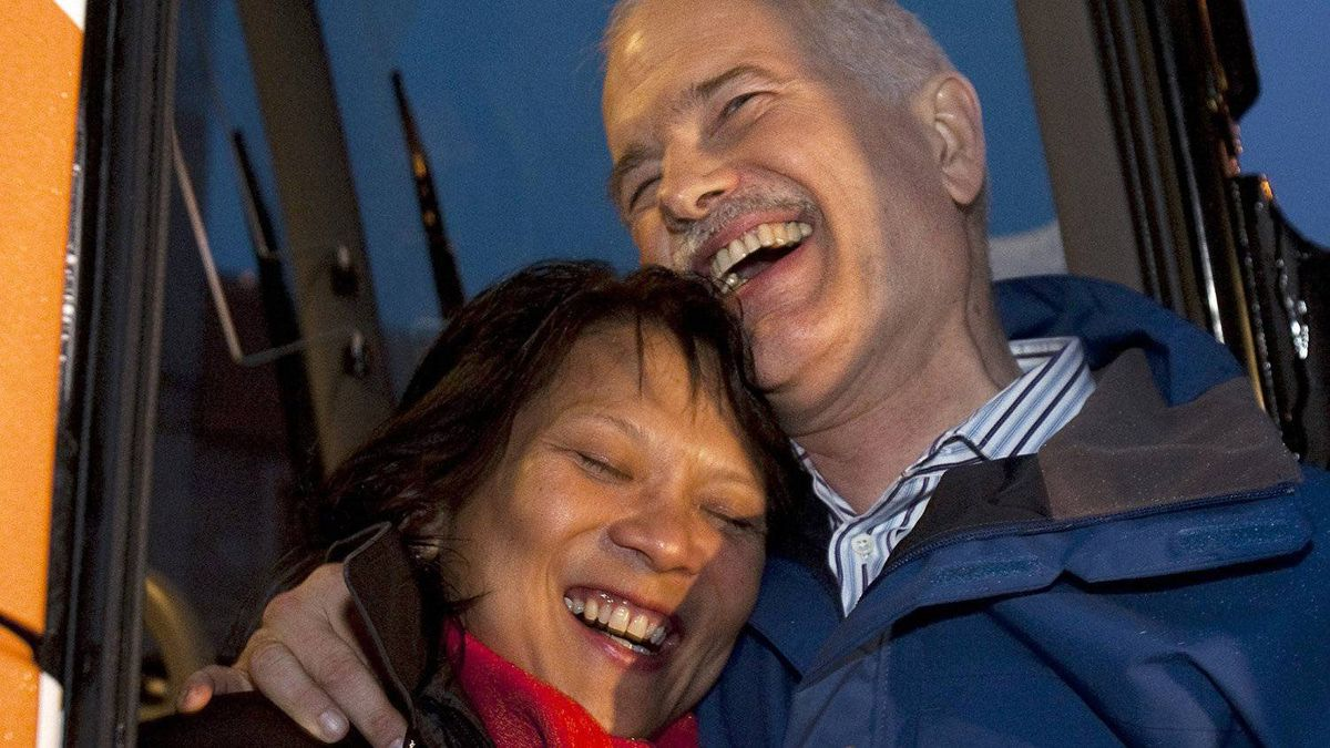 NDP Leader Jack Layton hugs his wife Olivia Chow on the steps of his campaign bus as he addresses supporters in Toronto on Sunday, May 1, 2011.
