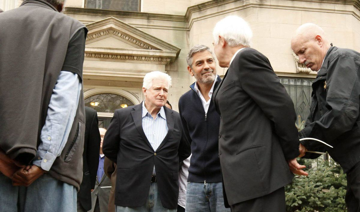 Actor George Clooney (3rd R) and his father Nick Clooney (2nd R) are arrested for civil disobedience after protesting at the Sudan Embassy in Washington March 16, 2012. Clooney was protesting the escalating humanitarian crisis in Sudan.