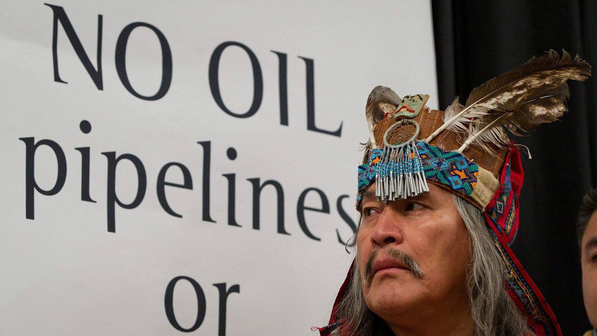 Chief Martin Louie, of the Nadleh Whut'en First Nation, looks on during a signing ceremony of a declaration opposing a crude oil pipeline and tanker expansion in Vancouver, B.C., on Thursday December 1, 2011.