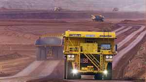 Autonomous haulage trucks like these are being tested at Rio Tinto's West Angelas mine site in Australia.
