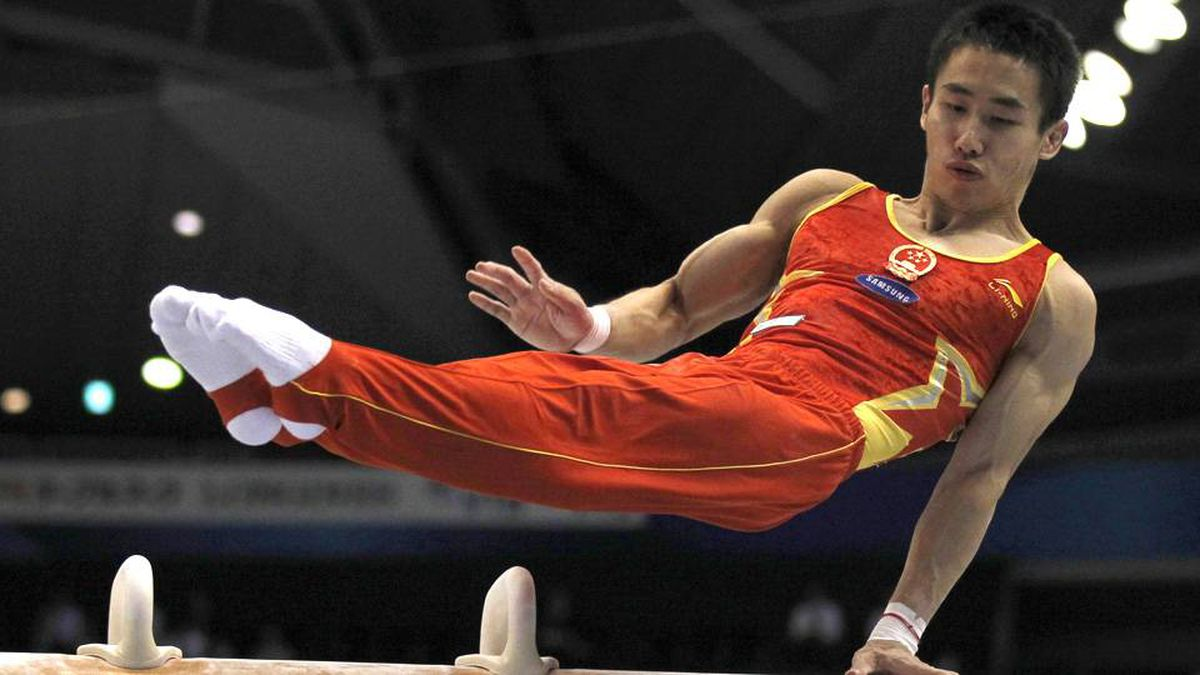 China's Yan Mingyong competes on the pommel horse during the men's team final at the Artistic Gymnastics World Championships in Tokyo.