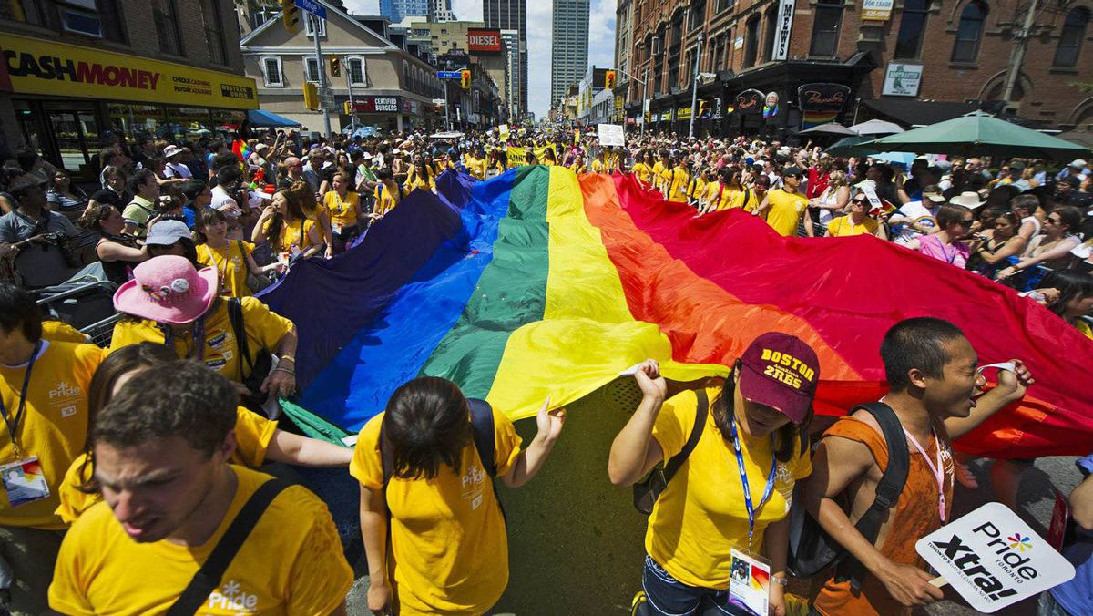 Participants hold a giant pride flag as they take part in the Gay Pride Parade in Toronto, July, 3, 2011.