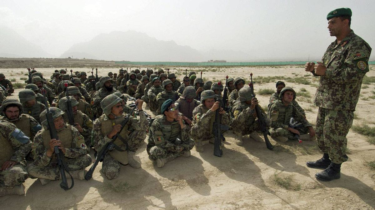 An Afghan National Army offider speaks to Afghan soldiers during a counter-ambush exercise at a Canadian-staffed training facility in Kabul on Aug. 10, 2011.
