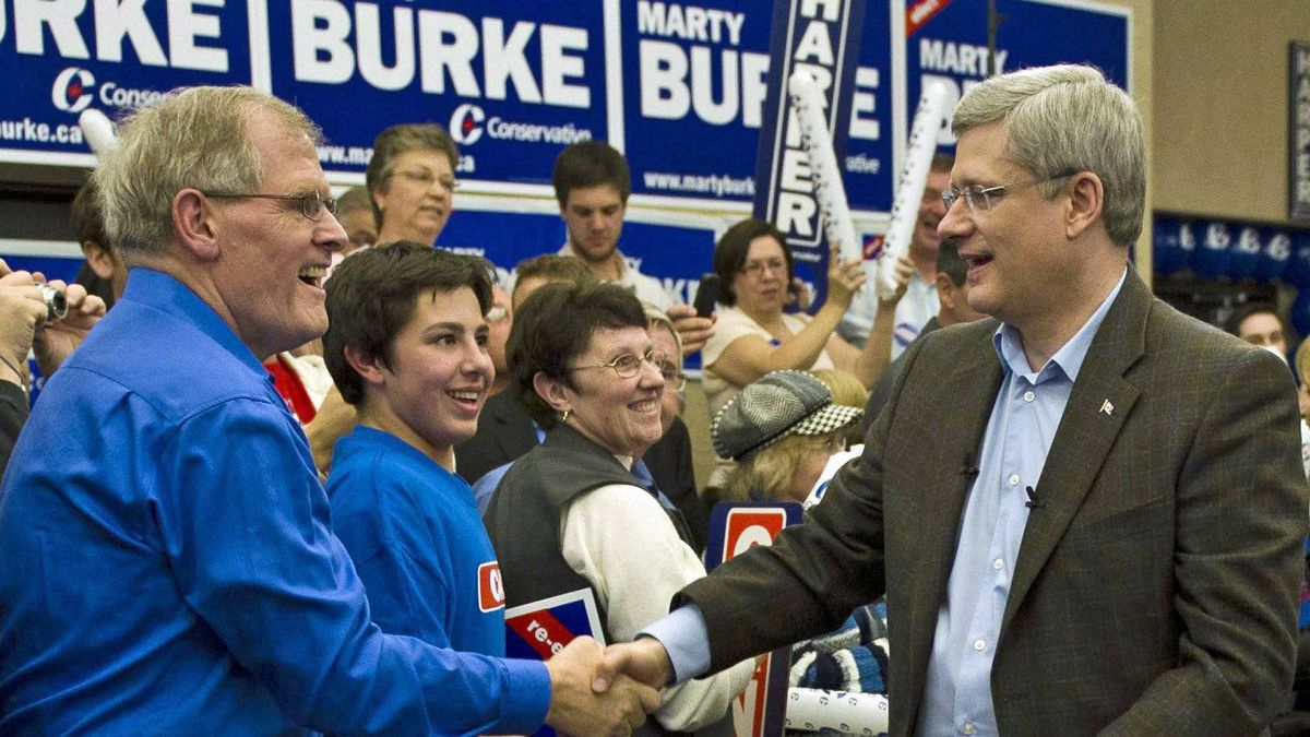 Prime Minister Stephen Harper shakes hands with supporters while campaigning for local candidate Marty Burke in Guelph, Ont., on April 4, 2011.