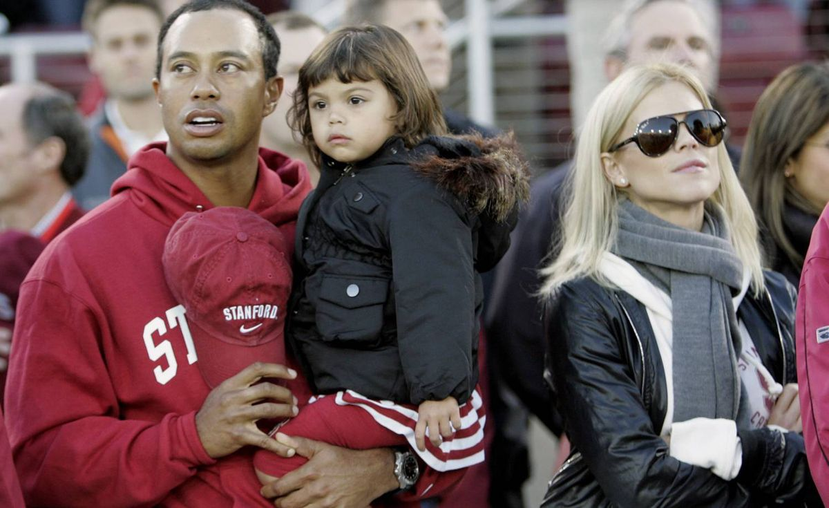 In this Nov. 21, 2009 photo, Tiger Woods with his daughter Sam and wife Elin Nordegren are seen before the start of a NCAA college football game between Stanford and California in Stanford, Calif.