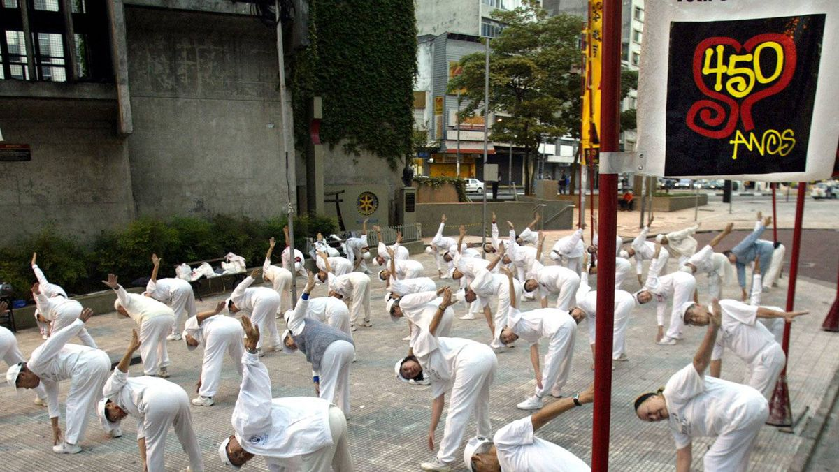 Elderly Japanese immigrants practice exercises during the early morning hours in Liberdade square in Sao Paulo, January 24, 2004. Sao Paulo, the world's biggest Japanese neighborhood outside of Japan, celebrated its 450th birthday anniversary on January 25, 2004.