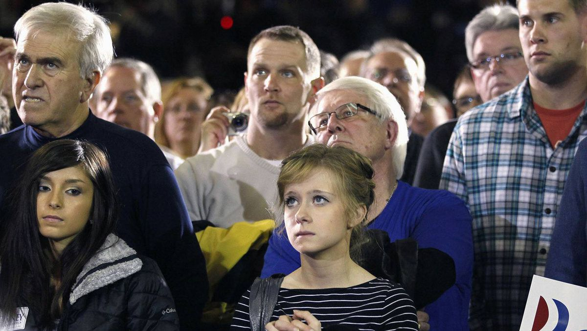 Supporters listen to Republican presidential candidate and former Massachusetts Governor Mitt Romney at a campaign in Marion, Iowa January 2, 2012.