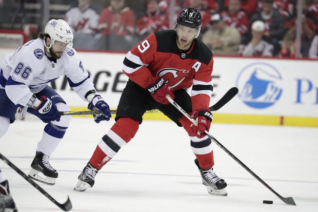 Taylor Hall skates by Tampa Bay Lightning right wing Nikita Kucherov during  the second period of Game 4 of their first-round series on April 18 c2389bfd610