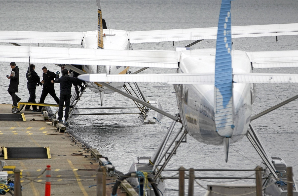Passengers offload from a Harbour Air seaplane in Vancouver, March 13, 2012.