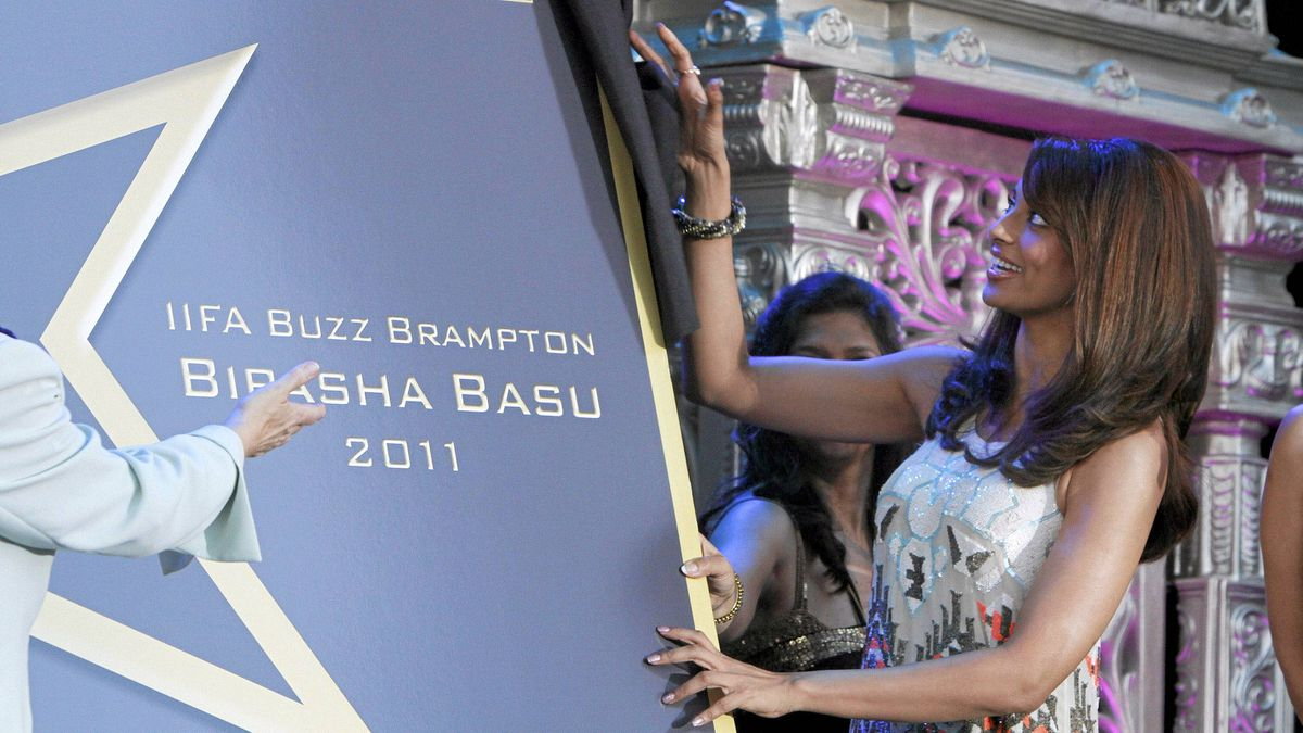 Bollywood star Bipasha Basu uncovers a commemorating plaque to celebrate IIFA in Toronto and her contribution to the film industry during the Walk of Fame at The Rose Theatre, Brampton Ontario June 17, 2011.