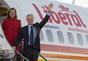 Former Liberal leader Stephane Dion and his wife Janine Krieber wave as they board the plane at the airport in Hamilton, Ont., on Wednesday., Sept.10, 2008.