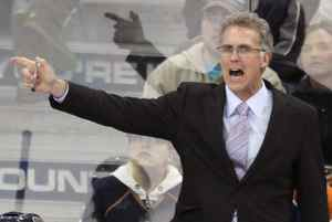 File photo: Former Edmonton Oilers' head coach Craig MacTavish screams at a referee during the first period of their NHL hockey game against the San Jose Sharks in Edmonton April 2, 2009. MacTavish will lead Canada's team at the Spengler Cup in their opening game on Saturday. REUTERS/Dan Riedlhuber