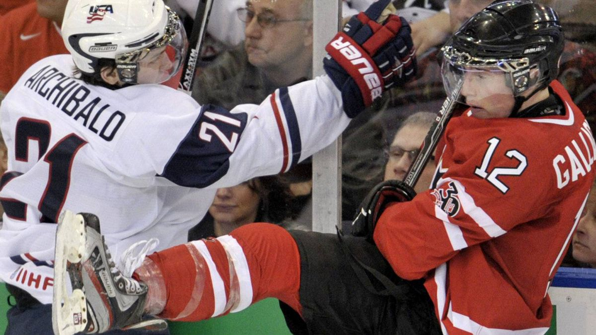 Canada forward Brendan Gallagher (12) and United States forward Josh Archibald (21) go into the boards during first period IIHF World Junior Championships hockey action in Edmonton on Saturday, Dec. 31, 2011. THE CANADIAN PRESS/Nathan Denette