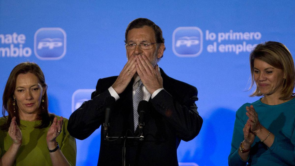 Prime-minister-designate Mariano Rajoy greets supporters after winning Spain's national election on Sunday, Nov. 20, 2011. He is accompanied by his wife, Elvira Fernandez Balboa, left, and Maria Dolores de Cospedal, secretary-general of the Popular Party.