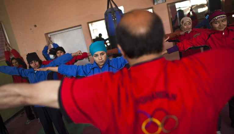 Afghan women practise inside a boxing club in Kabul December 26, 2011. Female boxing is still relatively unusual in most countries, but especially in Afghanistan, where many girls and women still face a struggle to secure an education or work, and activists say violence and abuse at home is common.