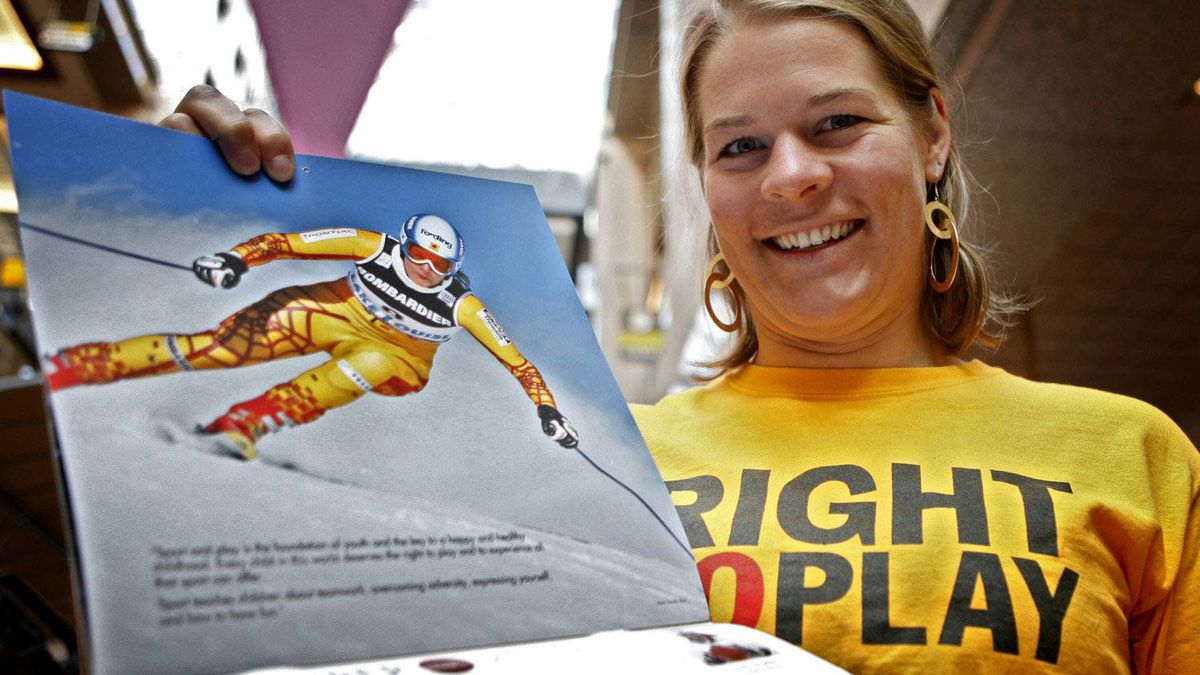 Canadian skier Emily Brydon holds her page open at the launch of an Olympic calendar fundraising project in Calgary, Thursday, Sept. 10, 2009. Proceeds from the calendars will support Right To Play sports programs across Africa, Asia, and South America.THE CANADIAN PRESS/Jeff McIntosh