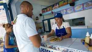 Cubans buy a meals t The Perfect Play in Havana. The restaurant has adopted a baseball theme that pays homage to the much-loved local team the Industriales.