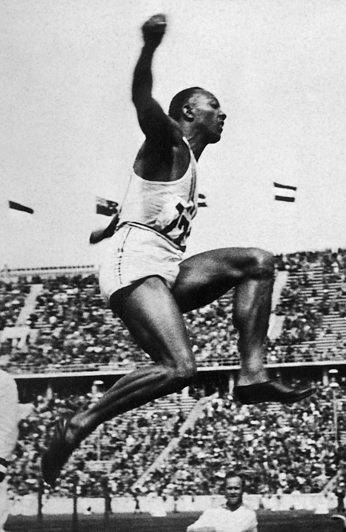 "US champion ""Jesse"" (James Cleveland) Owens is airborne during the long jump event, that he won, 09 August 1936 during Olympic Games in Berlin. Grandson of a slave and legendary athlete, ""Jesse"" Owens established 6 world records in 1935. Jesse Owens retained his 100m world record for 20 years and his long jump world record for 25 years."