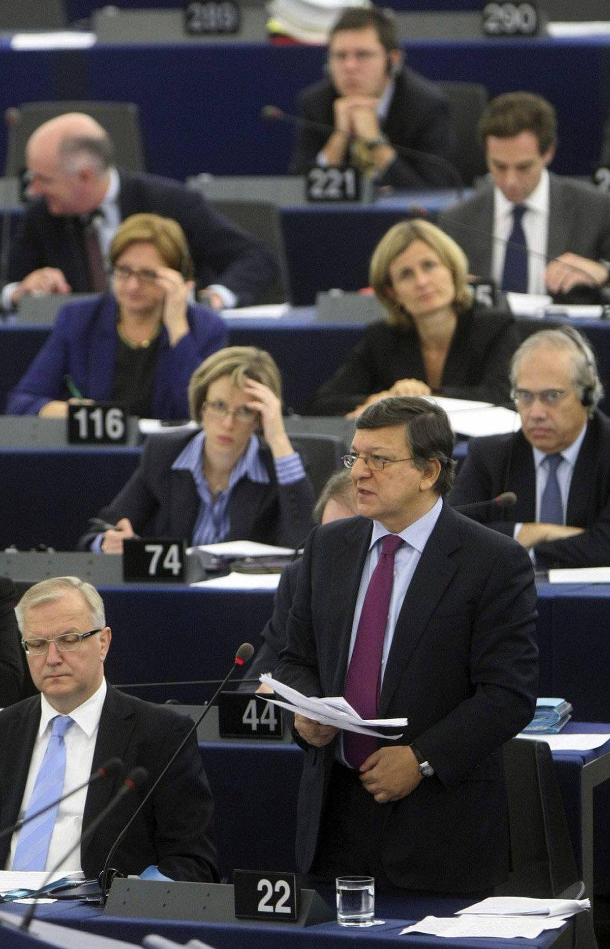 European Commission President Jose Manuel Barroso, right, addresses the European parliament in Strasbourg, eastern France, Thursday, Oct. 27, 2011.