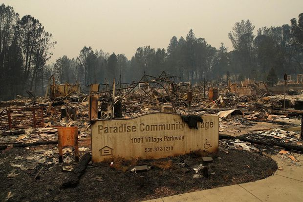A sign stands at a community destroyed by the Camp Fire in Paradise, Calif.