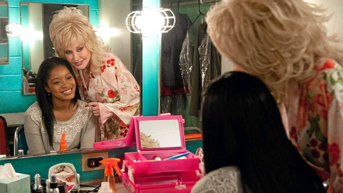 """Keke Palmer and Dolly Parton in a scene from """"Joyful Noise"""""""