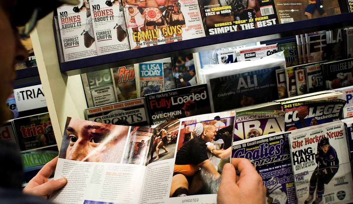 A customer checks out boxing magazines at the Chapters/ Indigo Eaton centre store in Toronto.