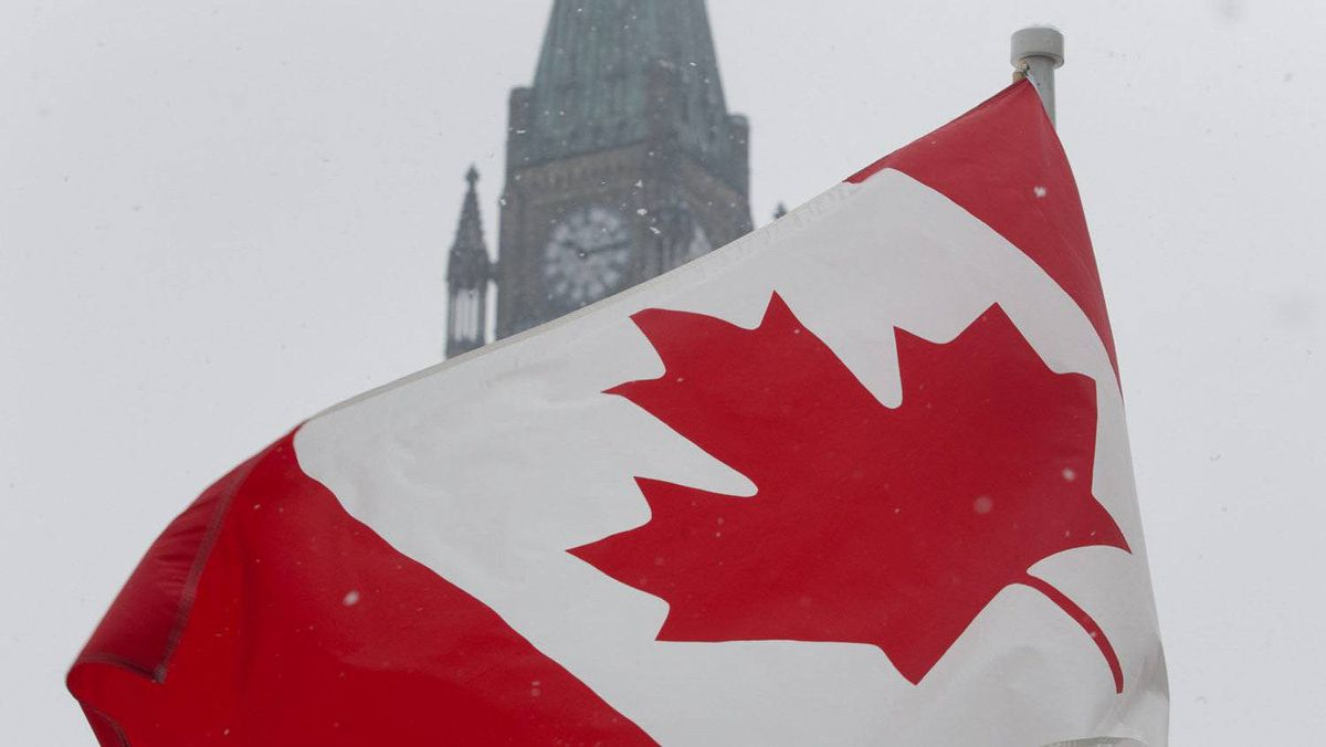 As part of National Flag day, a Canadian Maple Leaf flag flies near the Peace tower on Parliament Hill in Ottawa, Wednesday Feb.15, 2012. It was 47 years ago the red and white maple leaf flag was raised for the first time on Parliament Hill.