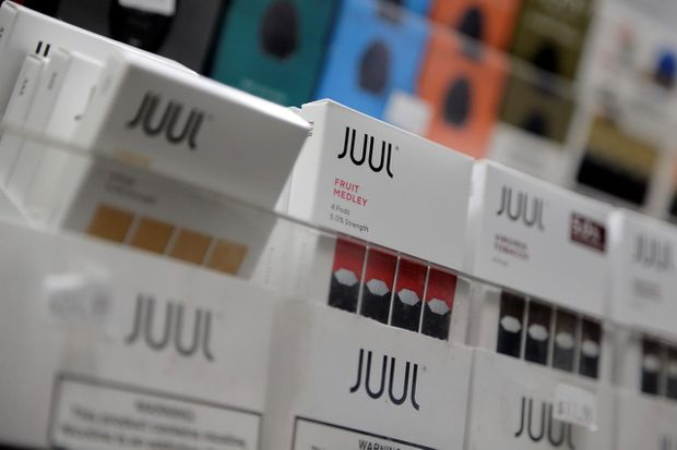 Juul stops all U.S. ads, boots CEO