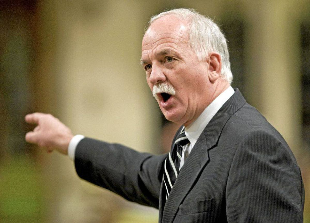 Vic Toews, then Treasury Board president, responds to the opposition during Question Period in the House of Commons on Feb.27, 2009.