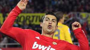 Real Madrid's Cristiano Ronaldo celebrates after scoring against Sevilla during their Spanish First Division soccer match at Ramon Sanchez Pizjuan stadium in Seville December 17, 2011. REUTERS/Marcelo del Pozo