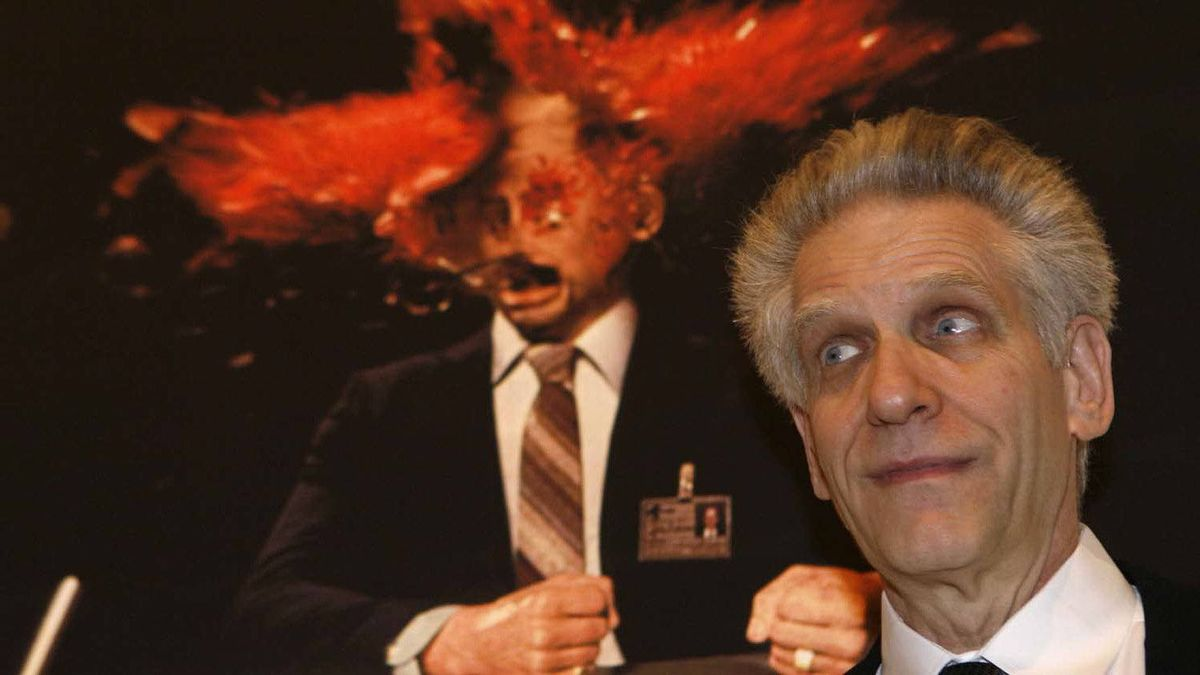 """Canadian director David Cronenberg's film """"Cosmopolis"""" is in competition at the 2012 Cannes Film Festival. He's seen here in front of a picture of a scene from his film """"Scanners"""" at an exhibit in Rome in 2008."""
