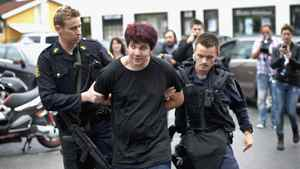 Norwegian police detain a young man, center, accused of carrying a knife outside a hotel where Norway's prime minister was meeting families of shooting victims in Sundvollen, Norway Saturday July 23, 2011.