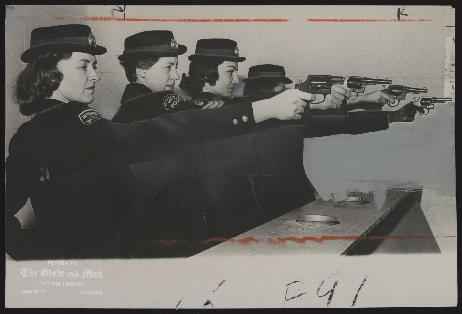 TORONTO metro Police Dept. The slender arm of the law -- Shirley Boileau,Sgt. Fern Alexander, and sisters Linda and Diana Boag practise shooting .38 special service revolvers