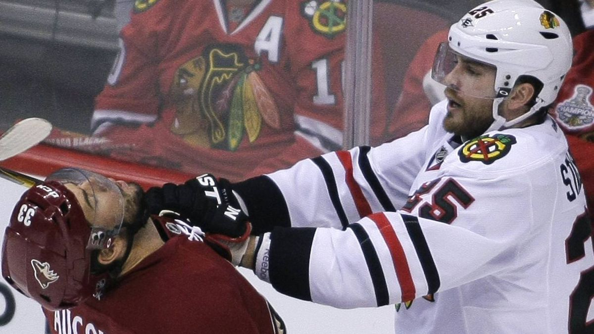 Chicago Blackhawks left wing Viktor Stalberg (25) hits Phoenix Coyotes defenseman Adrian Aucoin (33) in the first period during Game 5 of the NHL Western Conference quarter-final hockey playoffs in Glendale, Arizona April 21, 2012. REUTERS/Darryl Webb
