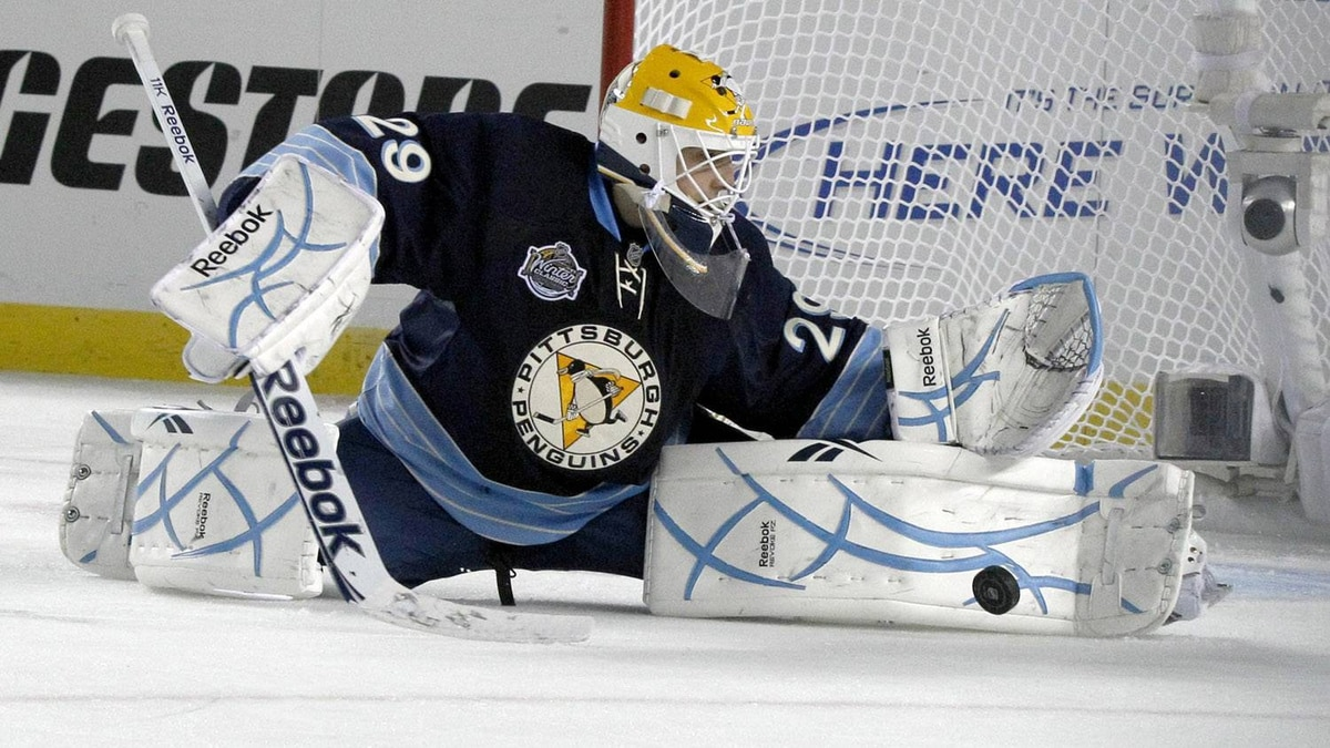 Pittsburgh Penguins goalie Marc-Andre Fleury (29) makes a save in the first period of the NHL Winter Classic outdoor hockey game against the Washington Capitals in Pittsburgh on Saturday, Jan. 1, 2011. (AP Photo/Keith Srakocic)
